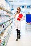 Beautiful blonde pharmacist in drugstore Royalty Free Stock Photos