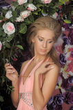 Beautiful blonde in a pink dress in the garden Stock Images