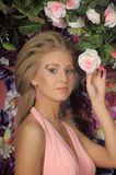 Beautiful blonde in a pink dress in the garden Royalty Free Stock Photos