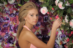 Beautiful blonde in a pink dress in the garden Stock Photography
