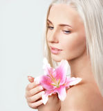 Beautiful blonde with pink lily Royalty Free Stock Image
