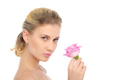 Beautiful blonde with pink rose Royalty Free Stock Photos
