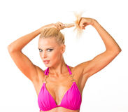 Beautiful blonde with ponytail. Beautiful blonde twirling her ponytail Royalty Free Stock Photography