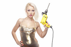 Beautiful blonde with a power drill Royalty Free Stock Photos