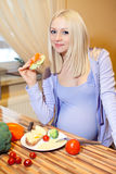 Beautiful blonde pregnant and healthy food Stock Photo