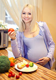 Beautiful blonde pregnant and healthy food Stock Image