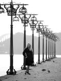 Beautiful blonde on promenade. Beautiful blonde lady staying among lanterns on promenade Royalty Free Stock Photo