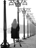 Beautiful blonde on promenade Stock Photo