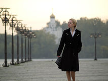 Beautiful blonde on promenade royalty free stock photo
