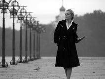 Beautiful blonde on promenade stock photos