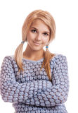 Beautiful blonde in pullover. Portrait of beautiful blonde girl in blue pullover on white Royalty Free Stock Image