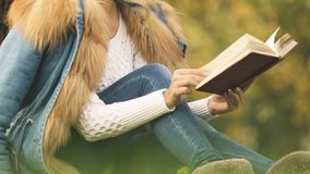 Beautiful blonde reading book, relaxing in park, romantic and creative person. Stock footage stock footage