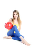 Beautiful blonde with red ball. Stock Photo