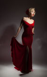 Beautiful blonde in a red dress Stock Photography