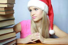 Beautiful blonde in red hubcap with books Royalty Free Stock Photos