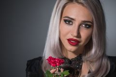 Beautiful blonde with red lips on a dark background in a collar. Portrait of a beautiful blonde with red lips on a dark background in a collar with spikes stock photos