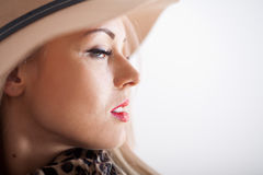 Beautiful blonde with red lips long eyelashes and a hat Royalty Free Stock Photos