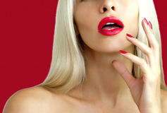Beautiful blonde with red lipstick Royalty Free Stock Photos