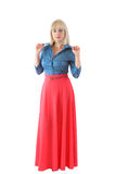 The beautiful blonde in a red skirt Stock Photography