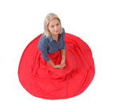 The beautiful blonde in a red skirt Royalty Free Stock Photography