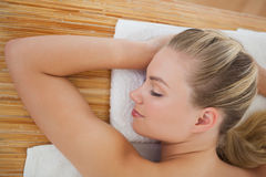 Beautiful blonde relaxing on massage table Royalty Free Stock Images