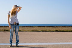 Beautiful blonde on road Royalty Free Stock Images