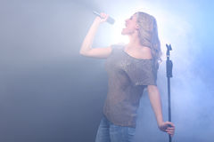 Beautiful Blonde Rock Star on Stage Singing Royalty Free Stock Photo