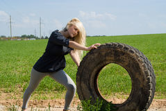 Beautiful blonde rolls wheel Stock Photography