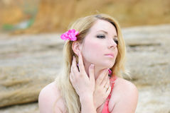 Beautiful blonde in rose gown. Beautiful blonde ashore epidemic deathes in rose gown Royalty Free Stock Images