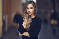 Beautiful blonde russian woman in urban background Royalty Free Stock Images