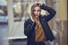 Beautiful blonde russian woman in urban background Stock Photos
