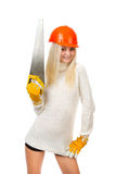 Beautiful blonde with a saw. Royalty Free Stock Image
