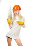 Beautiful blonde with a saw. Stock Photography