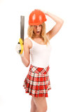 Beautiful blonde with a saw. Royalty Free Stock Photography