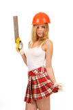 Beautiful blonde with a saw. Royalty Free Stock Photo
