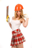 Beautiful blonde with a saw. Stock Images