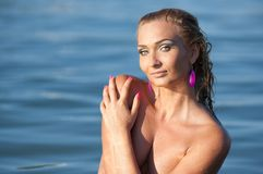 Beautiful blonde at sea Royalty Free Stock Images