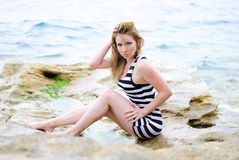 Beautiful blonde on the sea. Beautiful blonde ashore epidemic deathes Royalty Free Stock Photos
