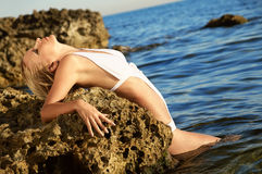 Beautiful blonde on sea Royalty Free Stock Images