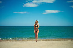 Beautiful blonde at the sea Stock Image