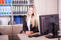 Beautiful blonde secretary at her work place Stock Photography