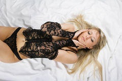 Beautiful blonde sex in bed Stock Photography