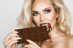 Beautiful blonde woman with a facial mask, beauty spa.Chocolate face mask. Beautiful blonde sexy woman model with a facial mask, beauty spa.Chocolate face mask Royalty Free Stock Images