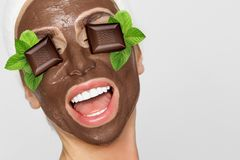 Beautiful blonde woman with a facial mask, beauty spa.Chocolate face mask. Beautiful blonde sexy woman model with a facial mask, beauty spa.Chocolate face mask Royalty Free Stock Photography