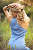 Beautiful blonde shows graceful back Royalty Free Stock Images