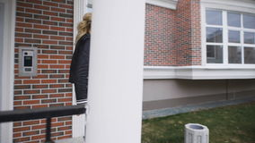 Beautiful blonde shows the keys to their new apartments in a stylish brick house. She is happy