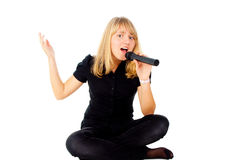 Beautiful blonde sings in microphone Royalty Free Stock Photo