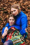 Beautiful blonde sisters twins in the autumn forest Stock Photography