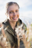 Beautiful blonde sitting in the countryside Royalty Free Stock Photos
