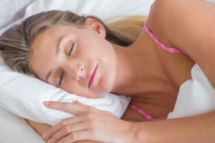 Beautiful blonde sleeping peacefully in bed Royalty Free Stock Photos
